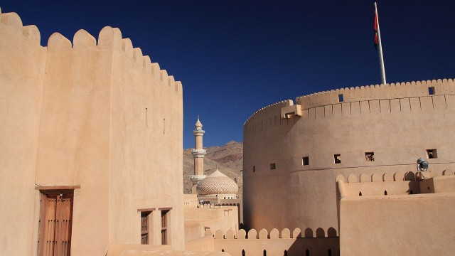 The Nizwa Fort is a large castle in Nizwa, Oman.
